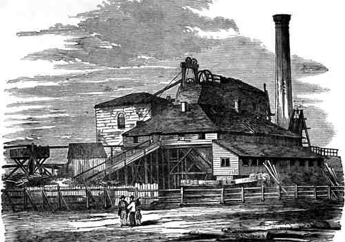 Engraving of a fenced building with tall power plant chimney and hit head machinery showing above roof