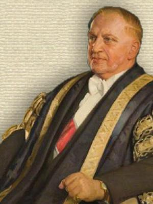 Edward Appleton in black ceremonial robe with gold trim, seated, upper body, facing left