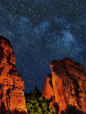 Photo of cliff walls with starry night sky background