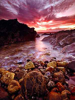 Photo of stream lit by red sunset