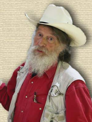 Photo of Robert Bakker, upper body facing forward,senior age, white beard, white cowboy hat