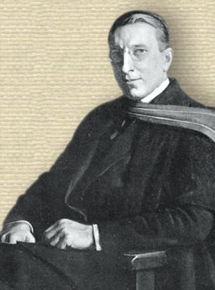 Photo portrait of Frederick Banting in academic robe, seated, upper body, facing left