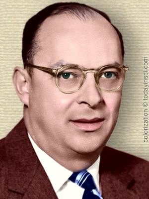 Photo of John Bardeen, head and shoulders, facing front. Colorization © todayinsci.com