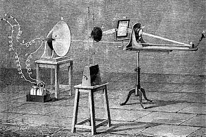 Engraving showing photophone apparatus with light source, mirror and speaking tube on transmitter, receiver and batteries.
