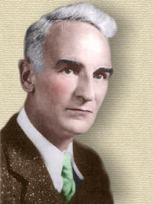 Photo of Eric Temple Bell, head and shoulders, facing slightly right. Colorization © todayinsci.com