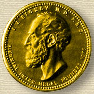 Photo of the obverse of Bigsby Medal, struck in gold, relief of John Bigsby, face, facing left.