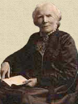 Elizabeth Blackwell, old age, facing front, seated in chair turned to left, book held in lap