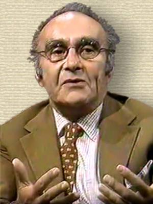 Video still of Jacob Bronowski from interview show (Parkinson), head and shoulders, facing front, hands gesturing front, palm up