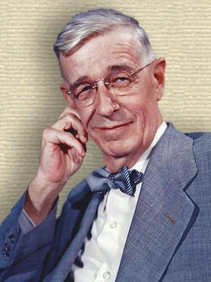 Photo of Vannevar Bush, upper body face forward, cheek resting on right hand