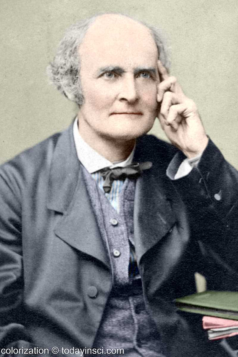 Photo of Arthur Cayley, seated, upper body. Colorization © todayinsci.com