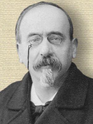Photo of Victor Cherbuliez, head and shoulders, facing forwards, wearing pince nez eyeglasses