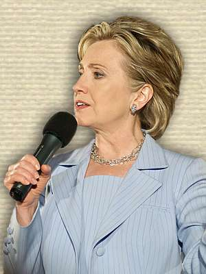 Photo of Hillary Clinton holding microphone at a Presidential Primary