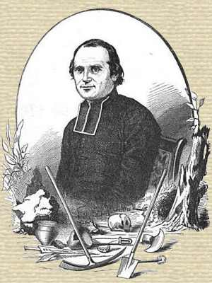 Engraving of Abbé Cochet, seated, upper body turned slightly left, facing forward, with frame including tools of archaeology