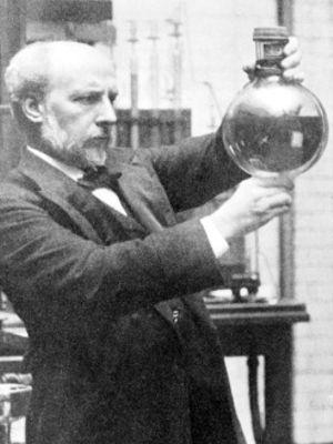 James Dewar holding a Dewar flask