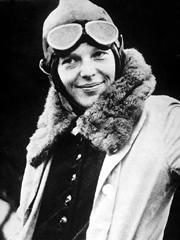 Amelia Earhart in flying jacket and googles, upper body