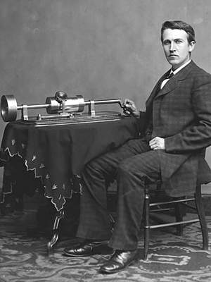 Thomas Edison photo - seated beside tinfoil phonograph on table
