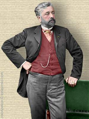 Portrait photo Gustave Eiffel, standing, frock coat, hand on chair back, 3/4 body, facing right, colorization © todayinsci.com