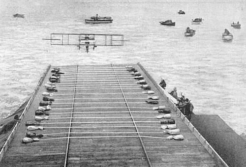 "Eugene Ely's airplane landing on ""Pennsylvania"" showing ropes across platform."