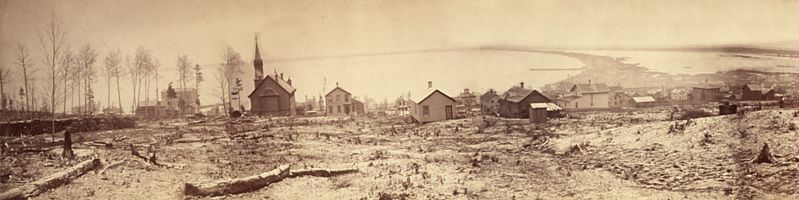 A view of Duluth, Minnesota looking waterward, taken December, 1870, showing felled trees and stacked logs