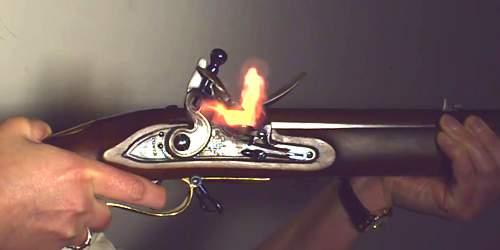Reproduction Flintlock rifle firing from video still