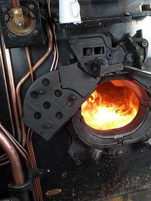 Fire box open showing coal burning inside.