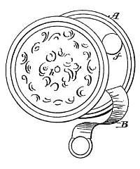 Patent diagram showing a circular case, decorated embossed side, and short piece of tape with ring end from a slot in body.