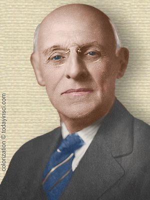 Photo of Abraham Flexner, head and shoulders facing front. Colorization © todayinsci.com