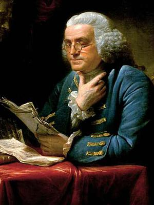 Painted portrait of Benjamin Franklin, seated behind table, wearing glasses, reading a paper
