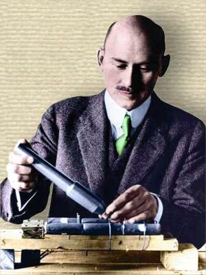 Photo of Robert Goddard at his work bench, upper body, facing front