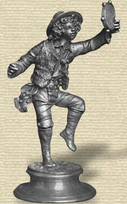 Photo Aluminum statuette on base. Boy, with hat over curly hair, vest & boots, dancing holding tambourine high, one leg in air