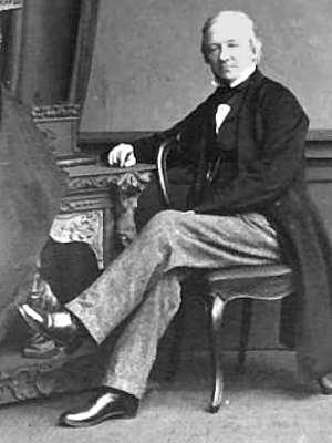 Robert Hunt, seated, full body