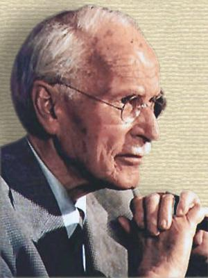 Photo Carl Jung, head and shoulders, facing right, hands clasped close to chin.