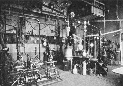 Photo of pipes interconnecting various compressors, pumps, and vessels in a laboratory