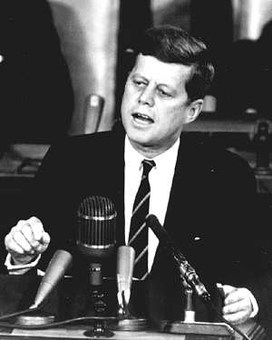 Photo of Presedent Kennedy - upper body behind lectern.