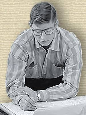 Photo of John Kobak (1962), upper body behind bench, looking down at plans, pencil in hand.