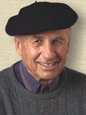 Photo of Walter Kohn, head and shoulders, facing forward, wearing beret.