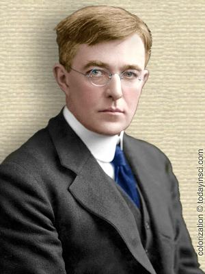 Photo of Irving Langmuir, suit and tie, upper body, facing forward. Colorization (only) © todayinsci.com