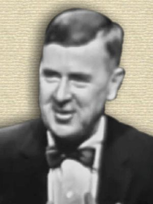 Video still of Ralph Lapp, head and shoulders, with bow tie and suit, facing front