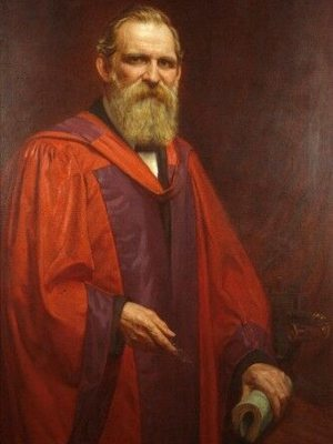 Portrait of Charles Lapworth in academic robe, standing 3/4 body, facing front.