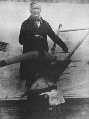 Stephen McCormick showing his plow - full-length photo