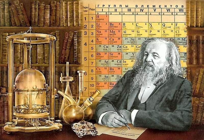 stamp souvenir sheet showing Mendeleev at his desk with laboratory glassware on it; background of bookshelves & periodic table