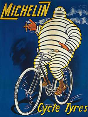 Early Michelin bicycle tyre ad showing the Michelin Man riding a bicycle.