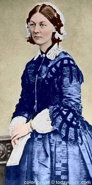 Florence Nightingale, standing, facing left. Colorization © todayinsci.com