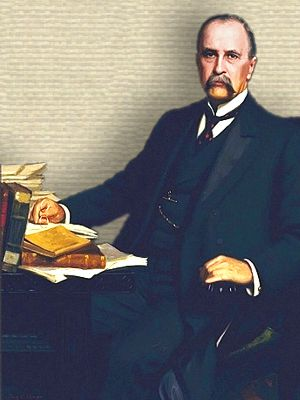 Portrait of William Osler seated at desk - full body