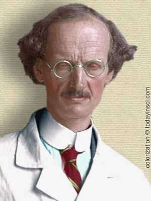 Photo of Auguste Piccard 1932 - head and shoulders in lab coat - colorization © todayinsci.com