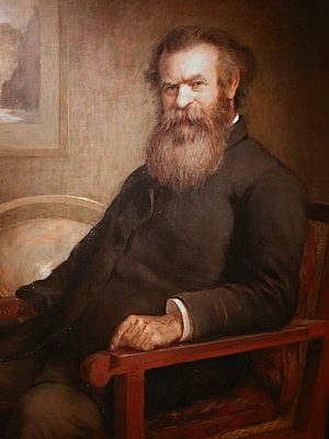 Oil portrait, John Wesley Powell, seated on chair, upper body, facing front. His empty right sleeve indicates his amputated arm