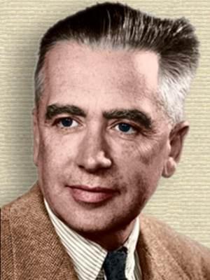 Photo of Emilio Segre head and shoulders facing left. Colorization © todayinsci.com