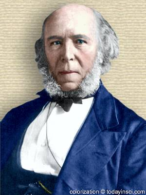 Herbert Spencer photo, face forward & shoulders, white hair, balding forehead, mutton chops beard. Colorization © todayinsci.com