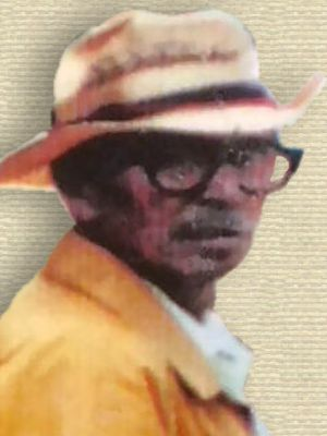 Photo of Hickory Starr, Sr. Standing, upper body facing right, head turned facing front, wearing straw hat