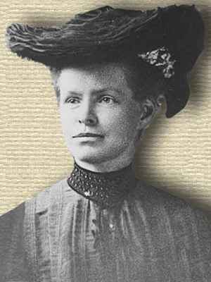 Photo of Nettie Stevens wearing wide brimmed hat, head and shoulders, facing left
